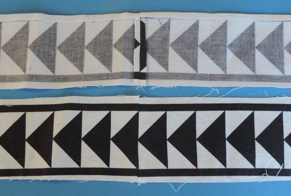 Strips joined along the base of a triangle.
