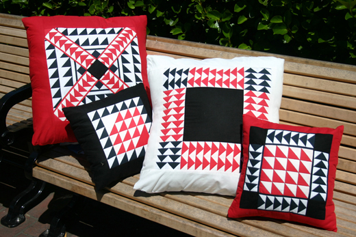 Here are two 16-inch pillows and two 24-inch pillows, using Sue Fox blocks.